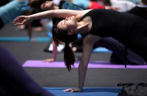 A yoga follower takes part in a 'Yogatho